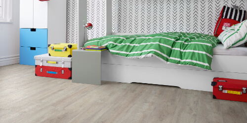 Cream flooring in Childs bedroom